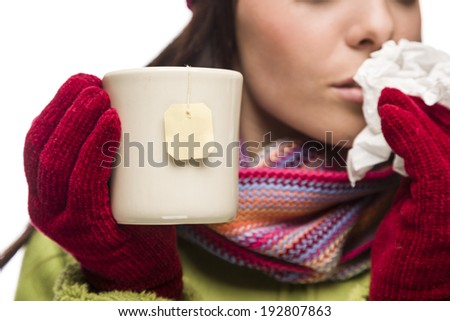 Young Sick Woman with Tissue Holding Cup with Blank Tea Bag Hanging. - stock photo