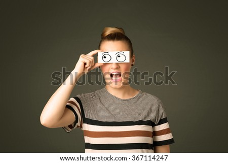 Young silly girl looking with hand drawn eye balls on paper concept - stock photo