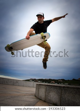Young skater training on the table - stock photo