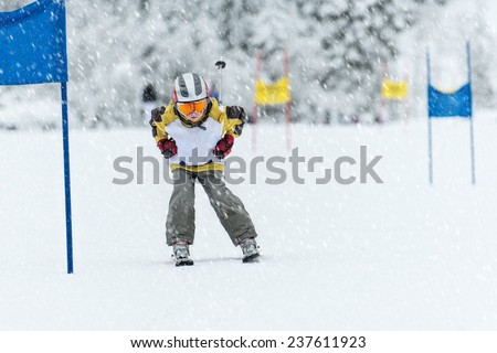 Young ski racer during a slalom competition - stock photo