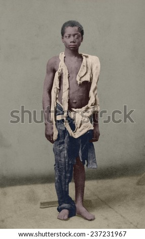 Young slave during the US Civil War clothed in rags. Ca. 1963 photograph by Armstead and White with digital color. - stock photo