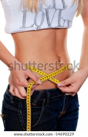 Young, slender woman, with tape measure their Body: - stock photo