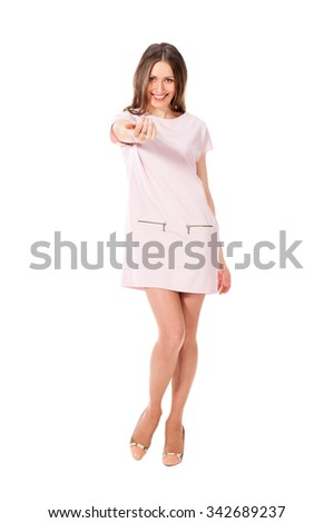 Young slim pretty woman in pink dress posing isolated on white background - stock photo