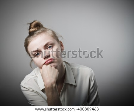 Young slim woman being bored of doing nothing. - stock photo