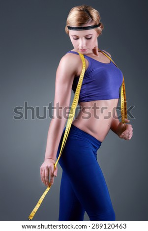 Young slim woman body shall be measured centimeter - stock photo