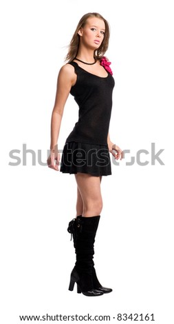 Young slim woman in black dress. Isolated on white. - stock photo