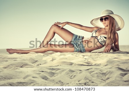 Young slim woman on beach. - stock photo