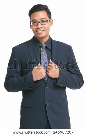 Young smart business man wear glasses posting two hands grab suit isolated on white - stock photo