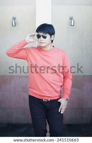young smart man wearing sun glasses lean building wall good looking posting  - stock photo