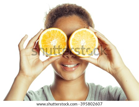 young smiling afro american woman with half oranges, lifestyle concept isolated on white background  - stock photo