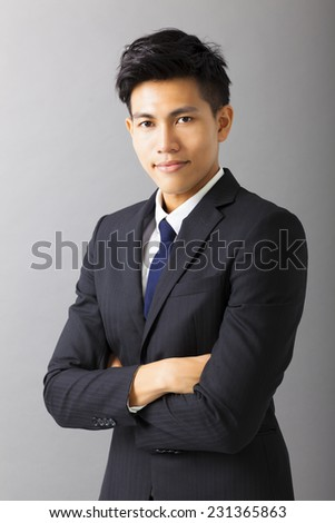 young smiling asian business man  - stock photo