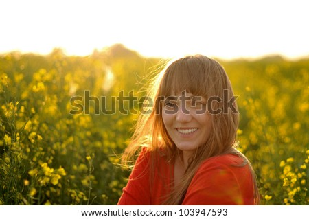 Young smiling attractive woman relaxing in the sunlight - stock photo