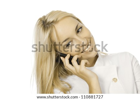 Young smiling beautiful doctor talks by mobile phone, isolated on white background. - stock photo