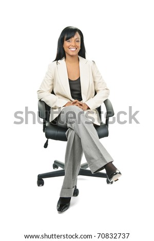 Young smiling black woman business manager sitting in leather office chair - stock photo