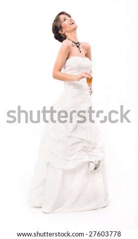 Young smiling bride with glass of champagne - stock photo