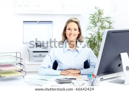 Young smiling  business woman working with computer - stock photo