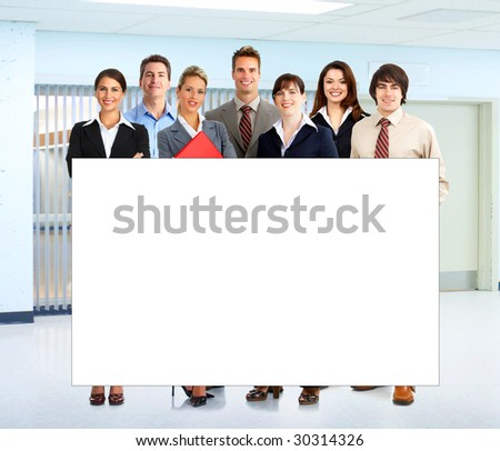 Young smiling  business woman working with laptop with a placard - stock photo