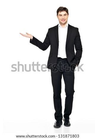 Young  smiling businessman holds  something on palm  isolated on white background. - stock photo