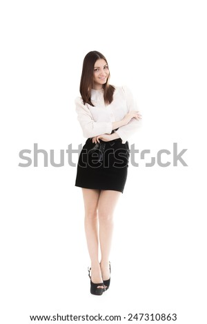 Young smiling businesswoman in black skirt and white shirt trains biceps lifting dumbbell weights, workout, business training, strength, progress, success, healthy lifestyle, leadership concepts - stock photo