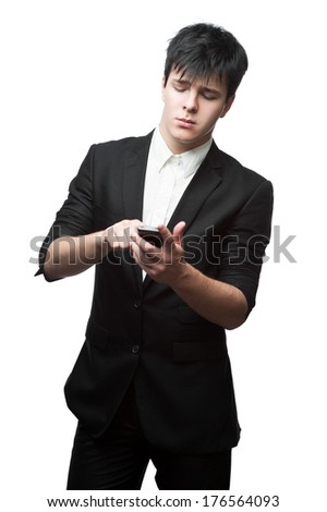 young smiling caucasian brunette businessman isolated on white background using cell phone - stock photo