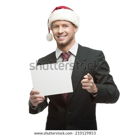 young smiling caucasian businessman in black suit and santa hat holding money isolated on white - stock photo