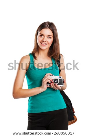 Young smiling caucasian woman with camera isolated over white background - stock photo
