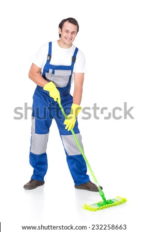 Young smiling cleaner man with cleaning broom, on the white background. - stock photo