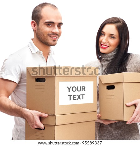 Young smiling couple carries a boxes - stock photo