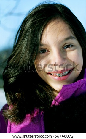 Young smiling girl, enjoying the outdoors - stock photo