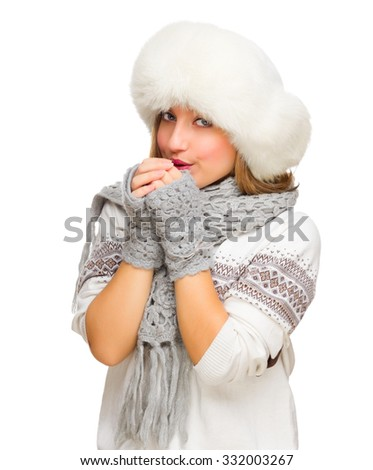 Young smiling girl in white sweater isolated - stock photo