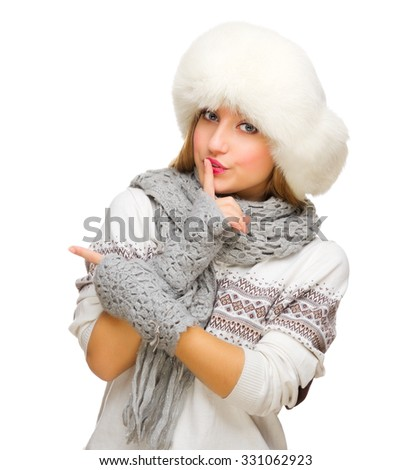Young smiling girl in white sweater showing pointing gesture isolated - stock photo