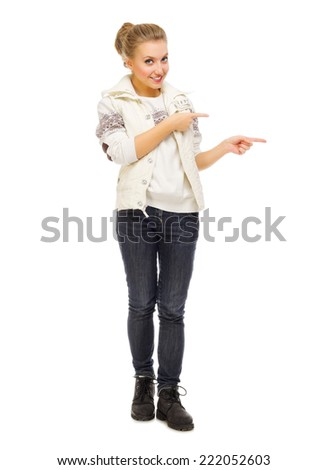 Young smiling girl show pointing gesture - stock photo