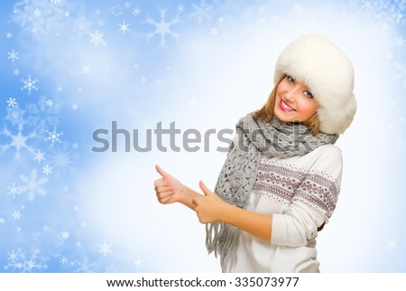 Young smiling girl showing ok gesture - stock photo