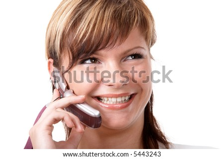 Young smiling girl speaking on the telephone isolated at the white background - stock photo