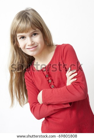 young smiling girl with long hair in red shirt - stock photo