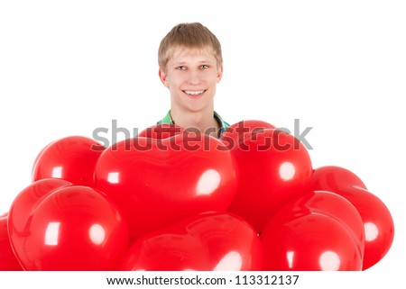 young smiling handsome guy with the heart shape balloons - stock photo