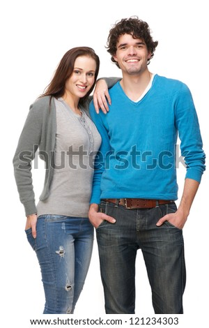 Young smiling happy couple isolated on white background. Boyfriend and girlfriend are in a relaxed pose and laughing. - stock photo