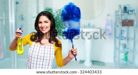 Young smiling maid. House cleaning service concept. - stock photo