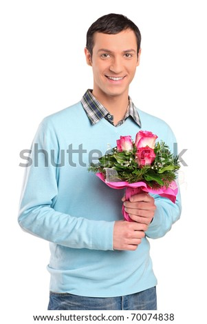 Young smiling man holding a bouquet of flowers isolated against white background - stock photo