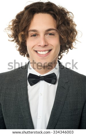 Young smiling man in tuxedo - stock photo