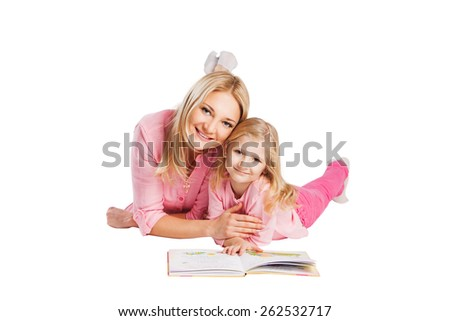 Young smiling mother with little daughter studying. Education, motherhood concept - stock photo