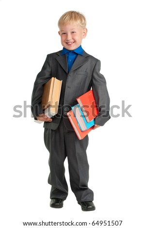 Young smiling schoolboy holding heavy books in his arms - stock photo