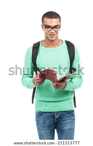 Young smiling student carrying bag. picture of travelling student with backpack and book - stock photo
