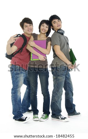 Young smiling students. Isolated over white background - stock photo