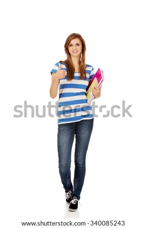 Young smiling teenage woman holding books. - stock photo