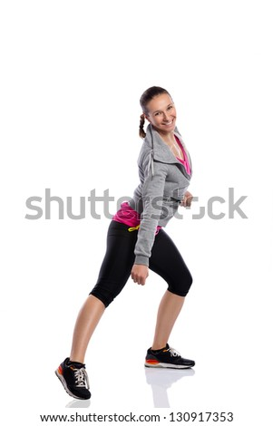 Young smiling woman doing fitness dance - stock photo