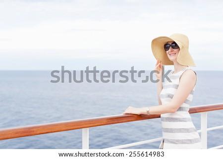 young smiling woman enjoying vacation at cruise ship - stock photo