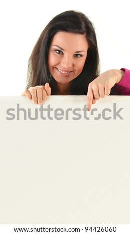 Young smiling woman holding a blank board isolated on white background - stock photo