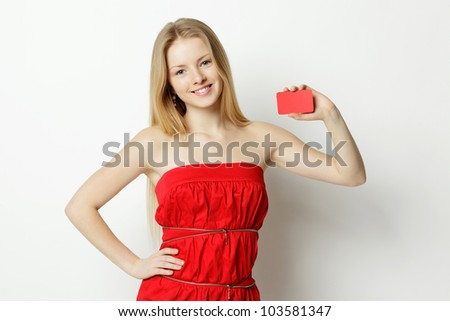 Young smiling woman holding blank credit card - stock photo