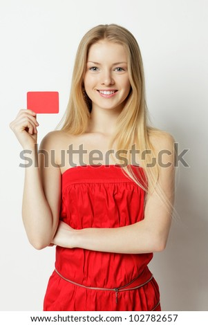 Young smiling woman holding credit card - stock photo